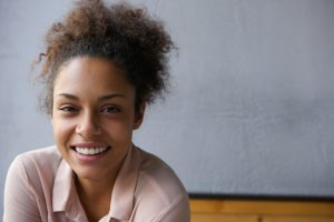 Happy young black woman smiling