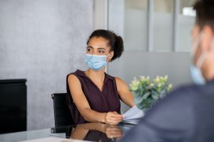 African business woman in office with face mask