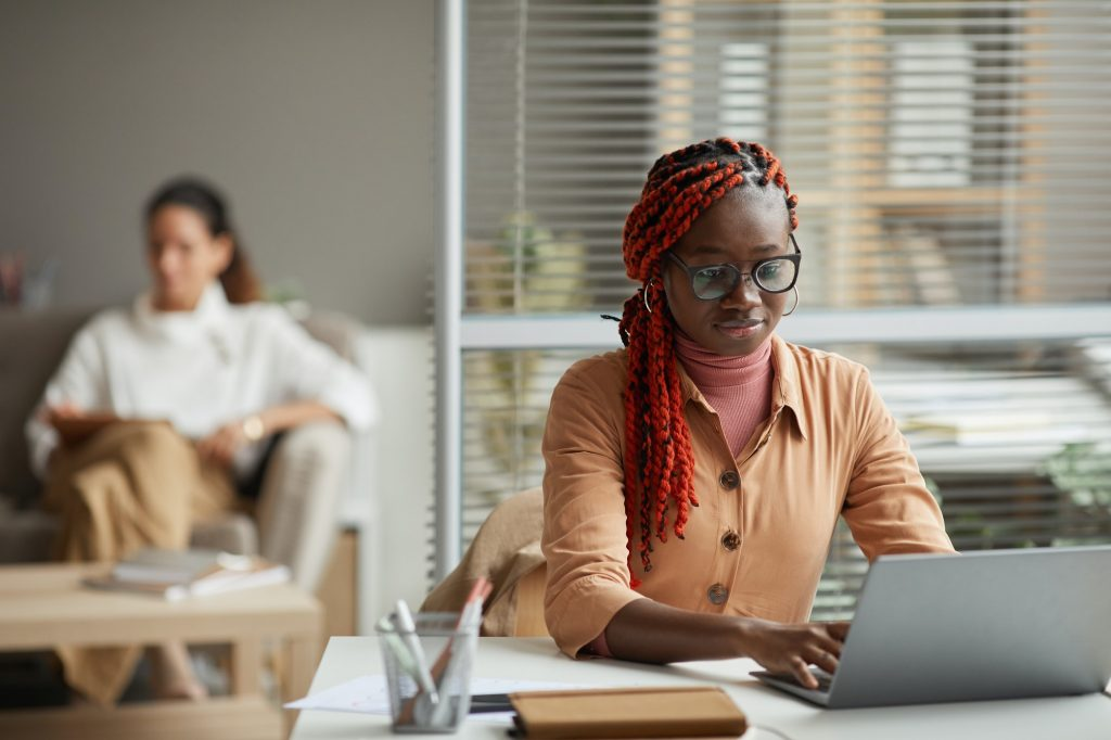 African-American Business Assistant Using Laptop