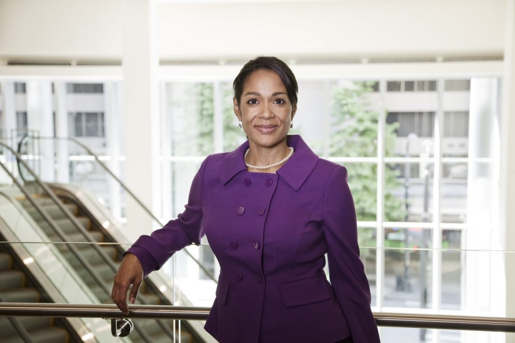 Black businesswoman in lobby of large business center