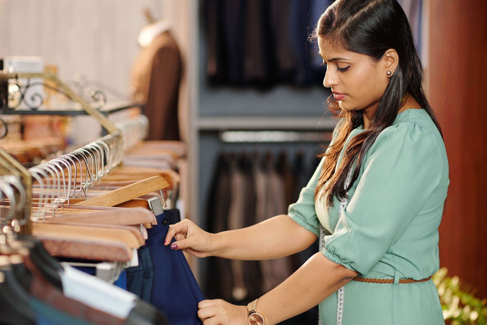 Woman buying trousers